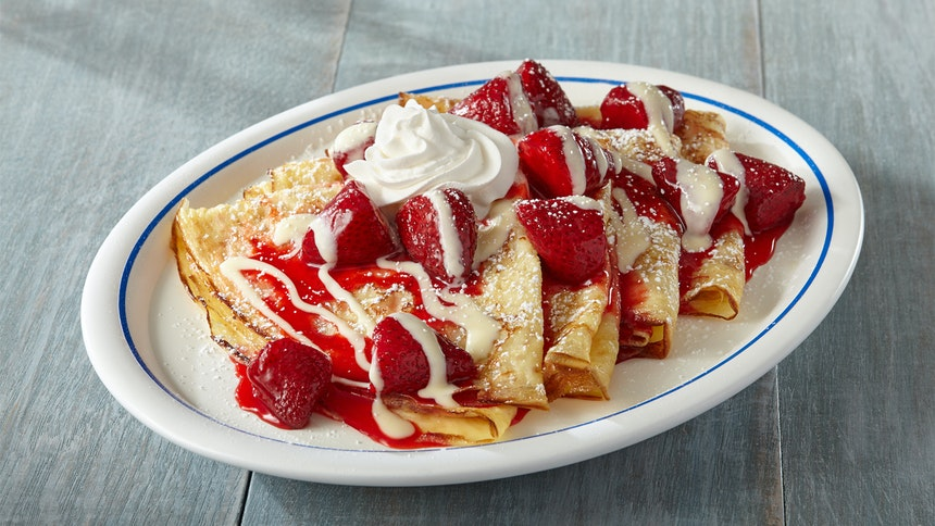 Classic crepes for two stuffed full of whipped cream, strawberries, and  blueberries and topped